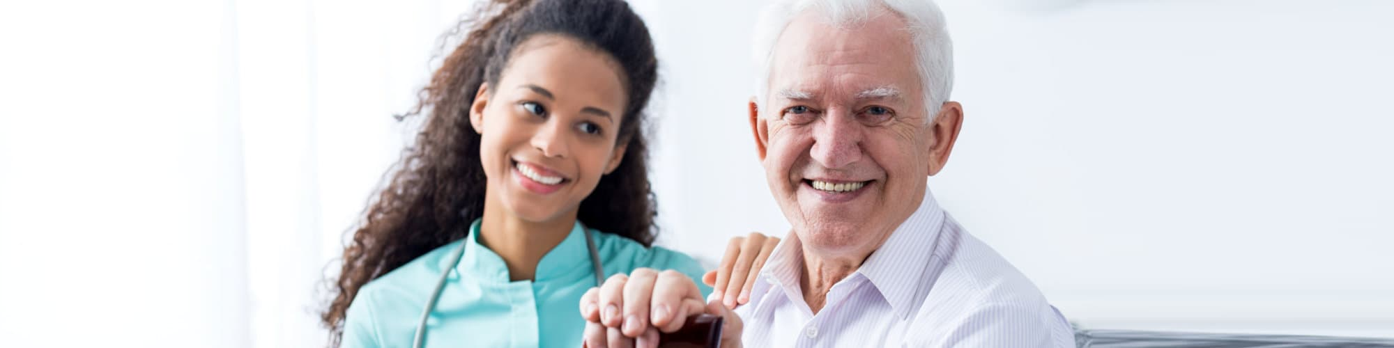 happy nurse taking care of older smiling man