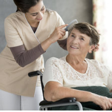 caregiver combing senior womans hair
